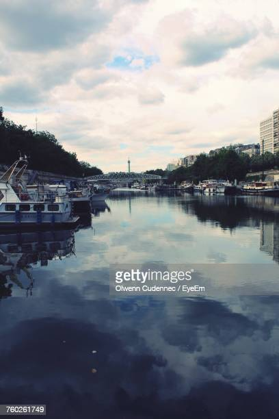 Boats Moored In Water Against Sky