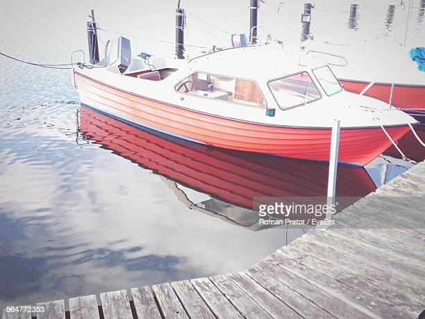 boats moored in water - roman pretot stock-fotos und bilder