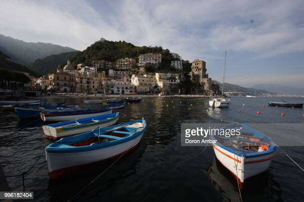 Boats moored near Mediterranean old town on seashore