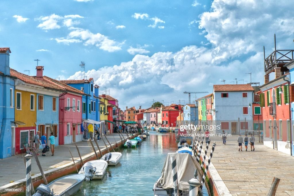 Boats Moored On Canal Amidst Buildings : Stock Photo