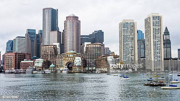Boats Moored On Charles River Against Boston Harbor