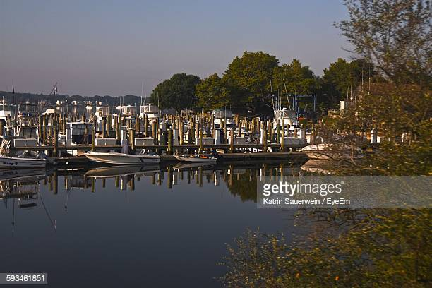 boats moored on harbor against sky - new haven connecticut stock pictures, royalty-free photos & images