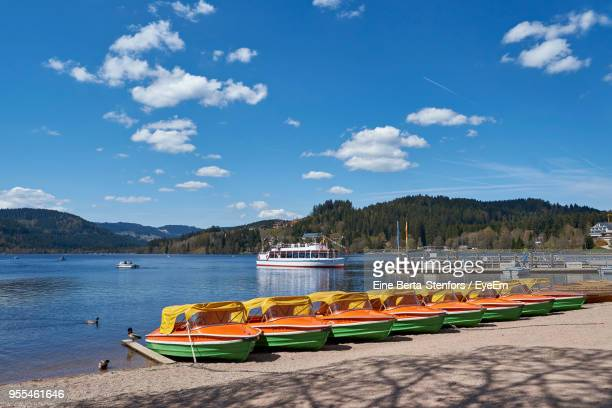 Boats Moored On River Against Sky