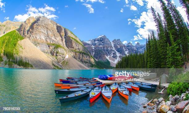boats moored on shore against sky - calgary stock pictures, royalty-free photos & images