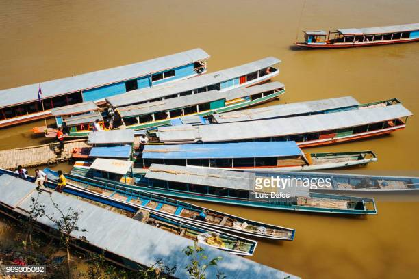 boats moored on the mekong river - dafos stock photos and pictures