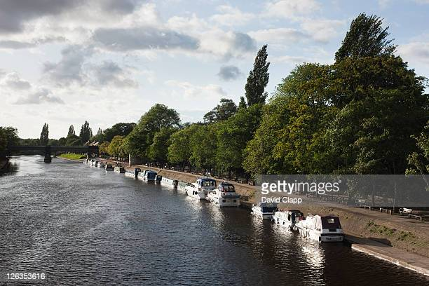 Boats moored on the River Ouse in York City, East Yorkshire, England, UK