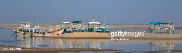 boats moored on the the chindwin river, myanmar - peter adams stock pictures, royalty-free photos & images