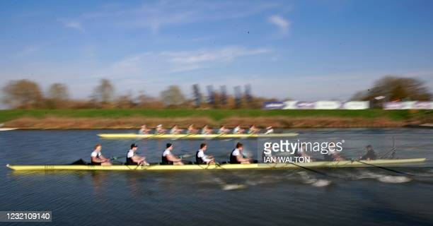 Boats move away from the start, Oxford nearest the camera, during the 166th annual men's boat race between Oxford University and Cambridge University...