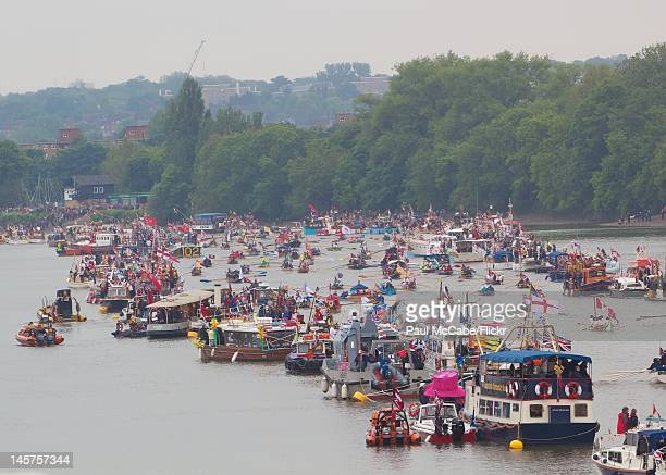 Boats mustering on the Thames between Hammersmith Bridge and Putney Bridge at the beginning of the Thames Diamond Jubilee Pageant on June 3,2012 in...
