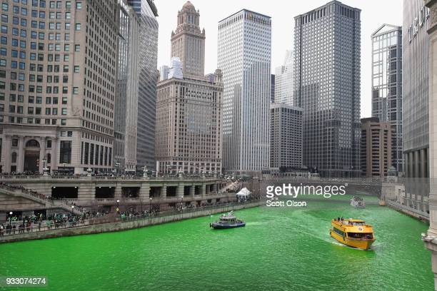 Boats navigate the Chicago River shortly after it was dyed green in celebration of St Patrick's Day on March 17 2018 in Chicago Illinois Dyeing the...