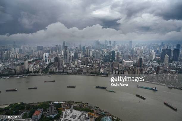 Boats navigate the Huangpu River as seen from the Oriental Pearl Television Tower in the Pudong district on August 29, 2020 in Shanghai, China.