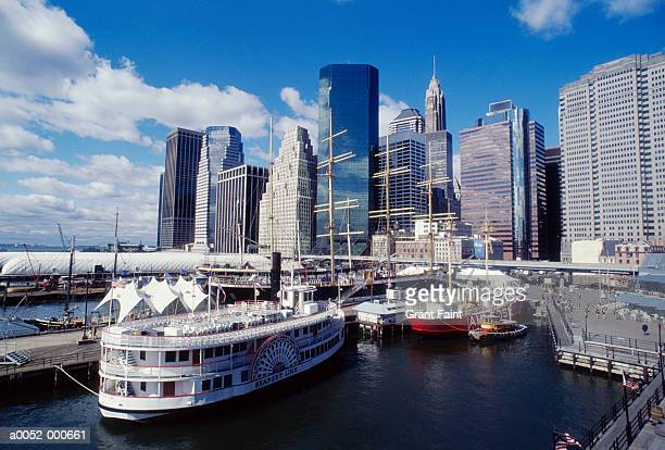 boats near skyscrapers - south street seaport stock pictures, royalty-free photos & images