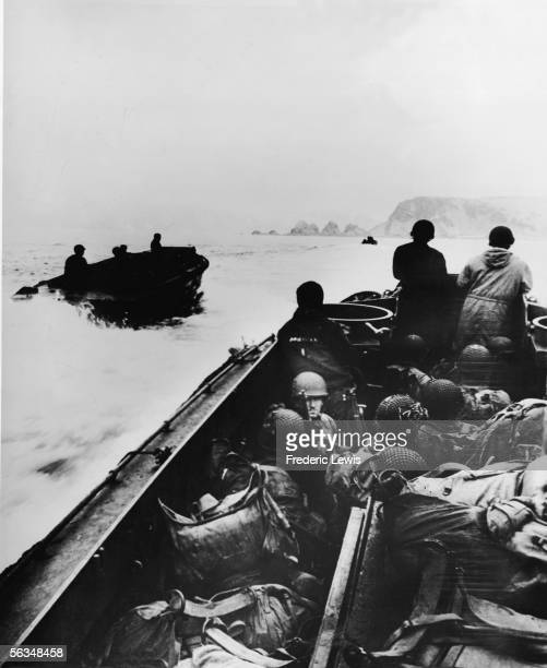 Boats of American troops arrive in Holz Bay and approach the shores of Attu in the Aleutian Islands Alaska May 11 1943 The Japanese occupied island...