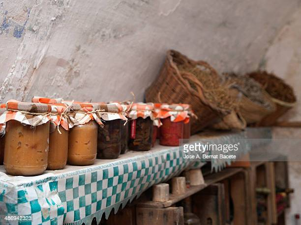 Boats of domestic jam in a rural pantry