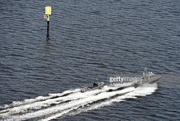 Boats of Finnish Border Guard on patrol in waters near Helsinki on on April 28 2015 Finland said Tuesday its navy had fired warning shots at a...