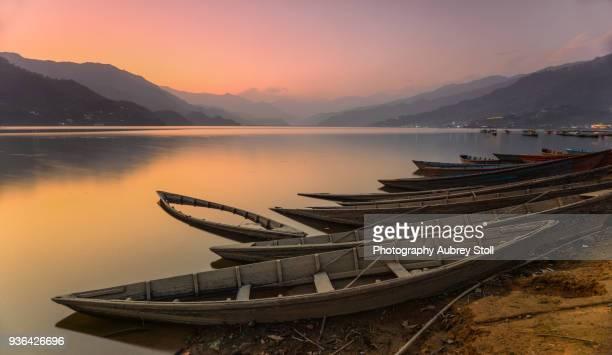 boats of phewa lake - pokhara stock pictures, royalty-free photos & images
