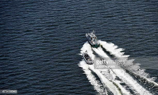 Boats of the Finnish border guard patrol in the waters off the coast near Helsinki on April 28 2015 Finland said Tuesday its navy had fired warning...