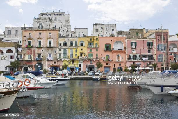 Boats of the touristic harbor of Marina Grande with coloured architecture in background on June 12 2012 in Procida Italy