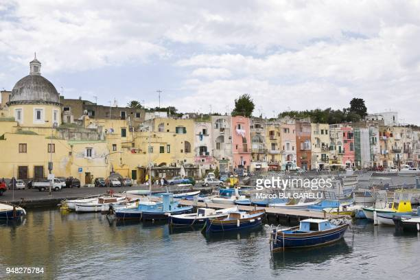 Boats of the touristic harbor of Marina Grande with the coloured architecture in background on June 12 2012 in Procida Italy