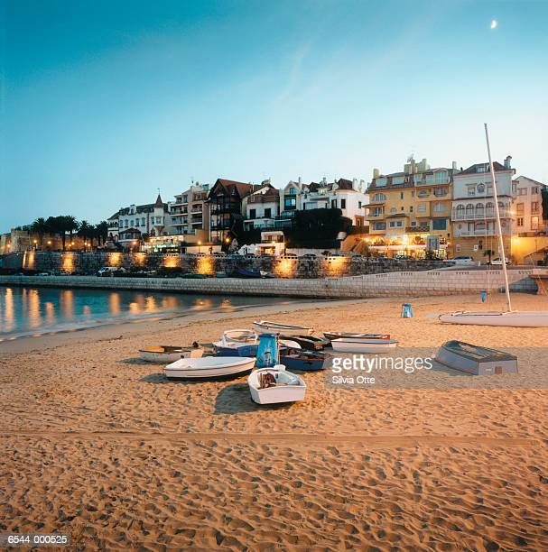 boats on beach at sunset - cascais stock photos and pictures