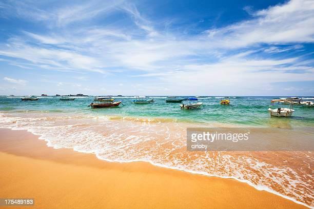Boote am Strand-Hikkaduwa/Sri Lanka