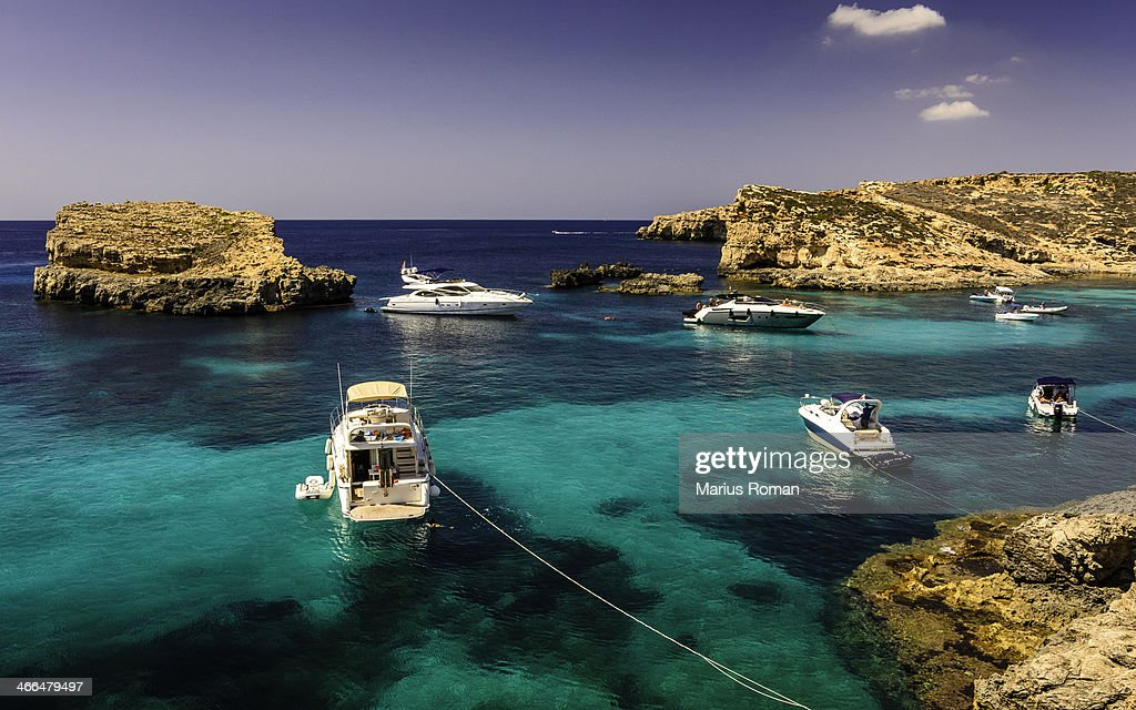 Boats on blue and turquoise water, Malta : Stock Photo