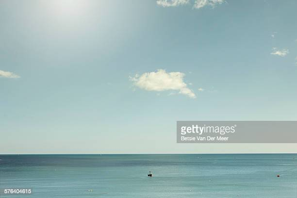 boats on calm sea on a sunny days - tranquil scene stock pictures, royalty-free photos & images