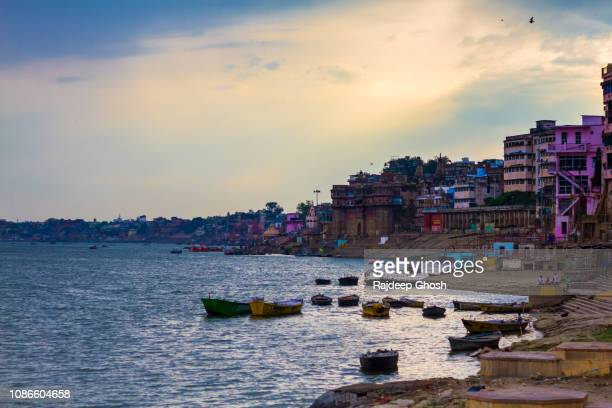 boats on ganges and riverbank of varanasi - river ganges stock pictures, royalty-free photos & images