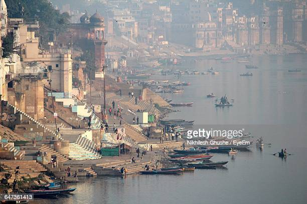 Boats On Ganges River By Historic Temples