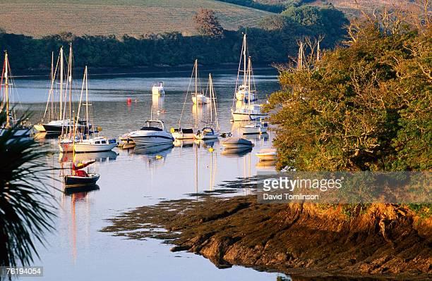 boats on kingsbridge estuary at east portlemouth, evening, salcombe, devon, england, united kingdom, europe - east stock pictures, royalty-free photos & images