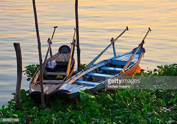 Boats on Mekong River at sunrise Vietnam