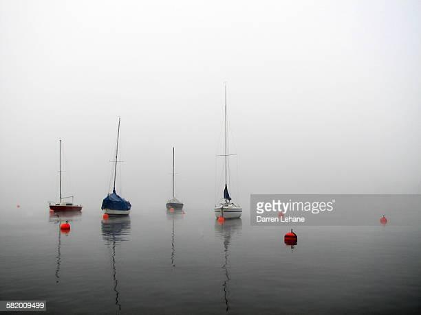 Boats on Misty Lake