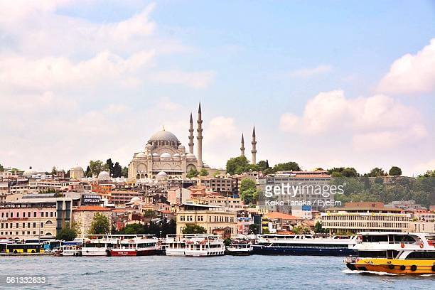 Boats On River By Buildings And Hagia Sophia Against Sky