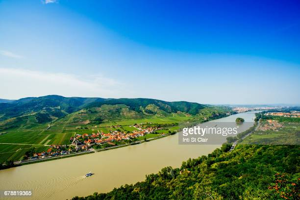 boats on river near village - danube river stock pictures, royalty-free photos & images