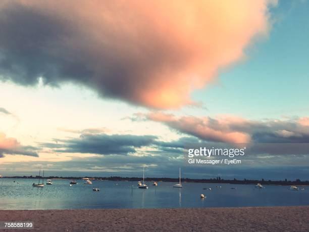 Boats On Sea Against Dramatic Sky During Sunset