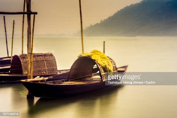 boats on sea against sky during sunset - guwahati stock photos and pictures