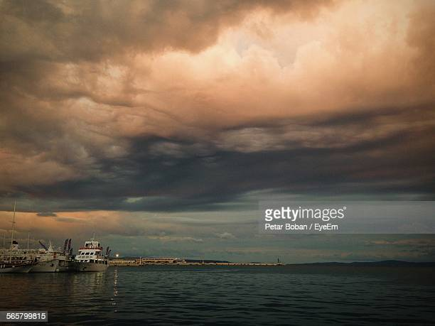 boats on sea against stormy cloudy sky - boban stock pictures, royalty-free photos & images