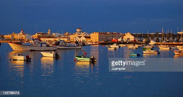 Boats on sea at sunset in Isla Cristina