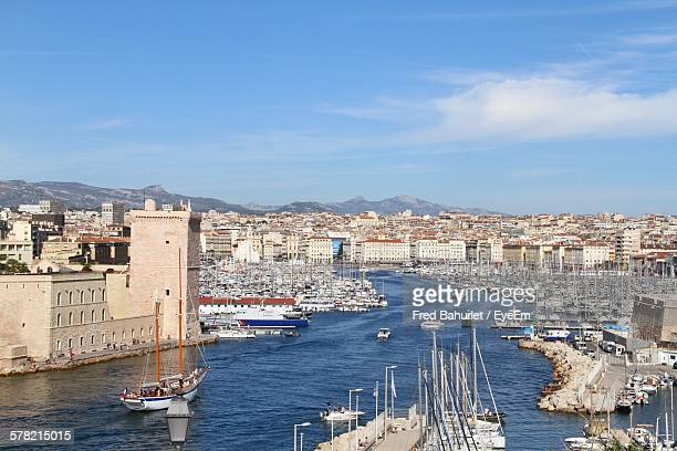 Boats On Sea At Vieux Port By Buildings Against Sky