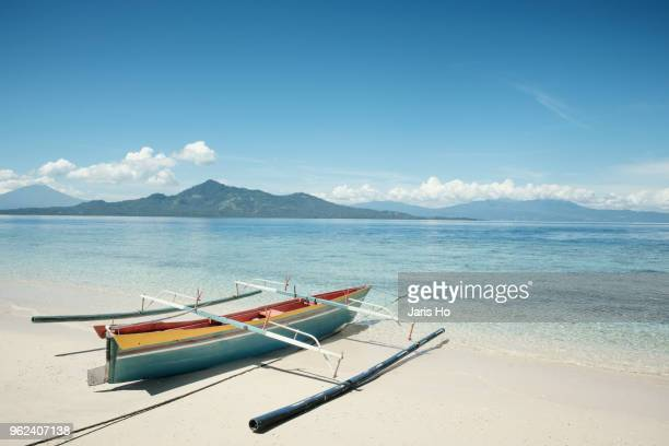 boats on shore - midday stock pictures, royalty-free photos & images