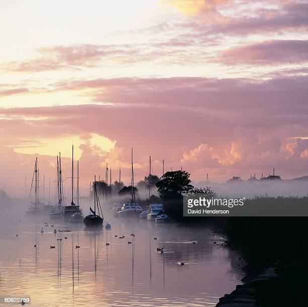 boats on thames river, dorset, wareham, england - wareham stock photos and pictures