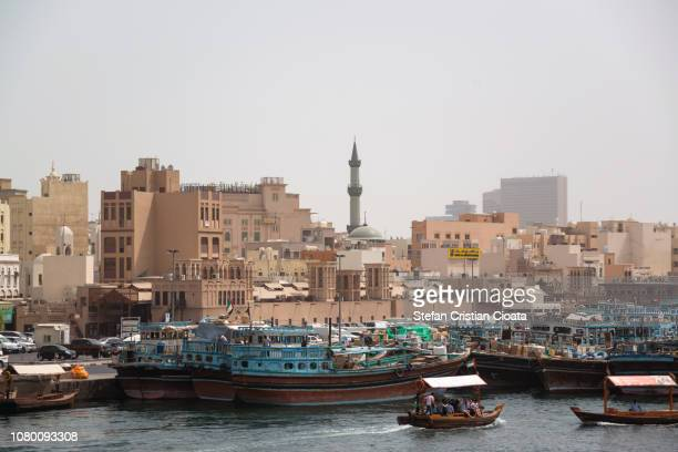 boats on the bay creek in dubai - tradition stock pictures, royalty-free photos & images