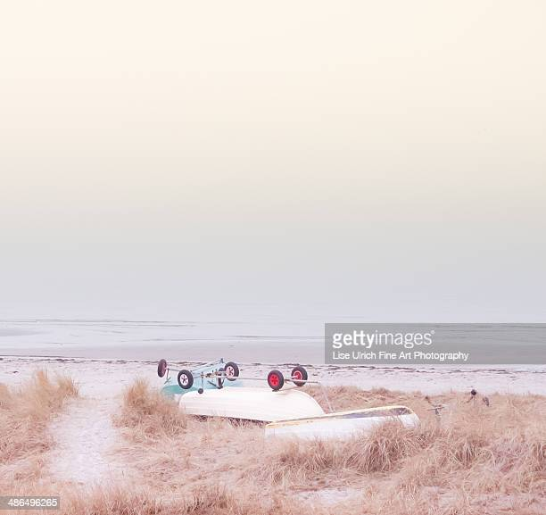 boats on the beach - lise ulrich stock pictures, royalty-free photos & images