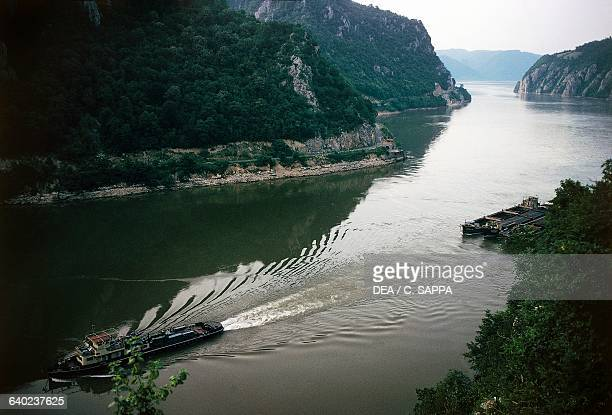 Boats on the Danube river near the Iron gates which form part of the boundary between Serbia and Romania