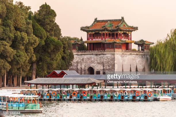 boats on the kunming lake at sunset with a pagoda pavilion behind them. - pagoda stock pictures, royalty-free photos & images