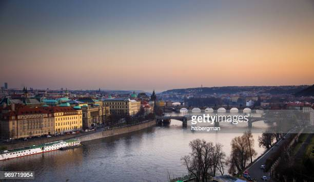 Boats on the River in Prague at Sunset