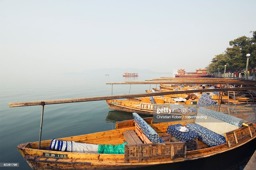 Boats on the waters of West Lake, Hangzhou, Zhejiang Province, China, Asia : Stock Photo