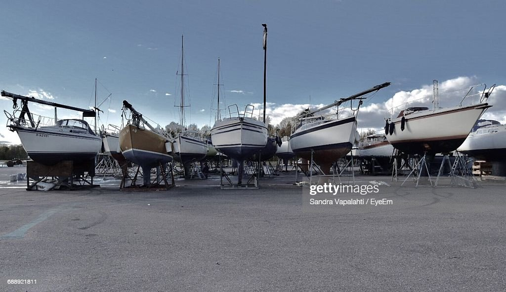 Boats On Trailer Against Sky At Harbor : Stock Photo