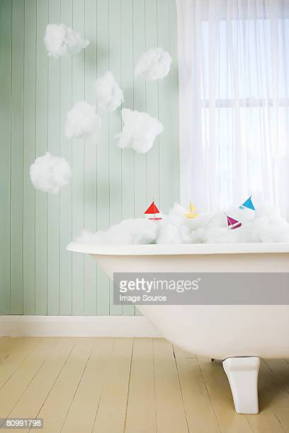 Boats on waves in a bath