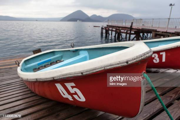 boats on wooden dock - quayside ストックフォトと画像